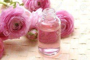 11080988-Flacons-de-parfum-avec-fleur-rose-Banque-d'images